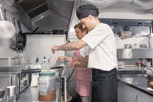two people chef assistant kitchen