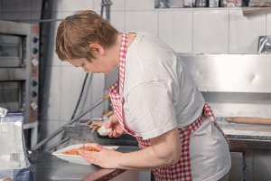 pasta dish woman, commercial kitchen