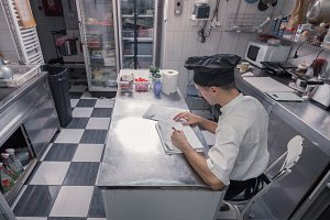 chef writing commercial kitchen