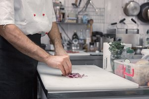 chef, cutting board, onions kitchen