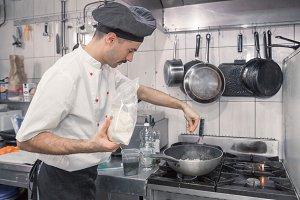 chef cooking pasta dish Parmesan