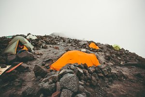 Camping tents in foggy Mountains