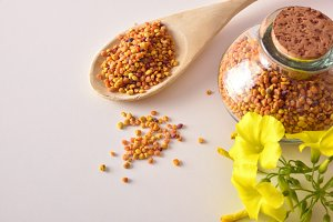 Grains of bee pollen on table top