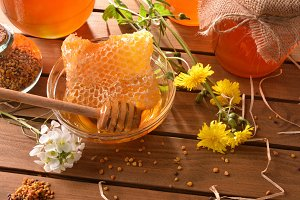 Honeycomb with honey on wood table
