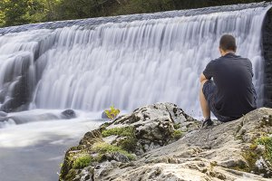 Man watching the water flow