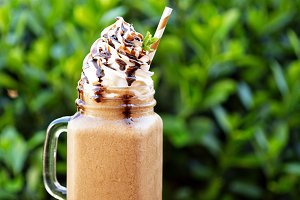 Chocolate frappe coffee with whipped cream outside