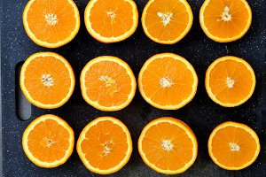 Half orange on a dark tray