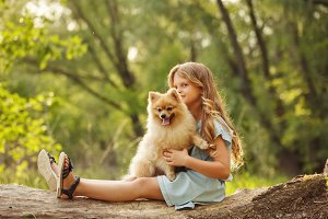 Little girl hug Spitz
