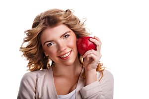 Girl with curly hair hold red apple