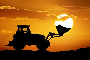Tractor and sun into shovel bucket