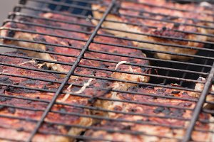 Grilling skewers or shashlik on barbecue grill. Selective focus