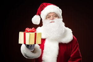Santa Claus with gift box in hand
