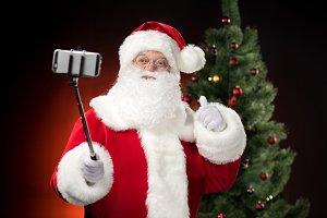 Santa Claus taking selfie