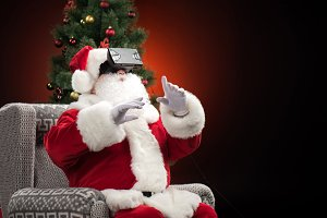 Santa Claus wearing VR headsets