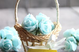 spring sale idea, tag and flowers in a small basket