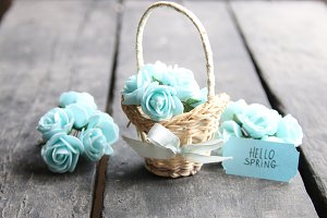 hello spring tag and flowers in a small basket