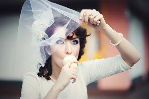 Funny bride eats an ice-cream