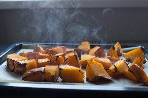 roasted pumpkin slices on a baking sheet. Home cooking