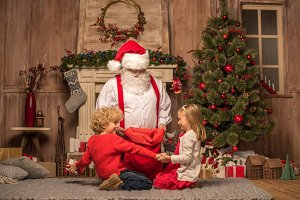 Santa Claus showing presents