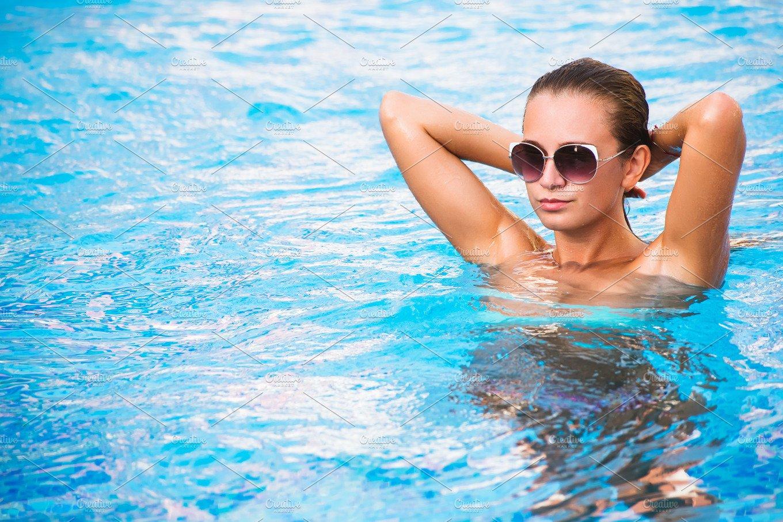 beautiful tanned sexy girl in bikini posing in swimming pool holiday photos creative market