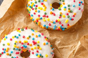 Donuts glazed with various sprinkles