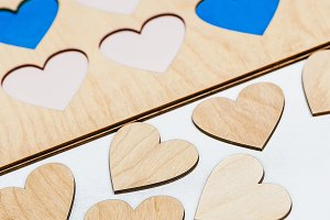 Carved small wooden hearts on table
