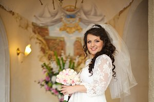 Brunette bride in the hotel hall