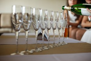 Empty champagne flutes on the table
