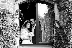 Stunning newlyweds behind the window