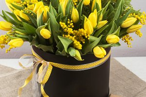 Bright spring bouquet of tulips and mimosa flowers
