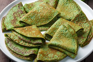 pancakes with spinach on white plate