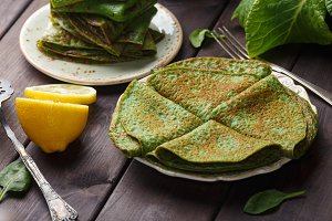 pancakes with spinach on wood table