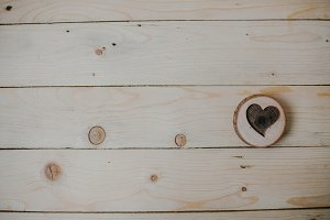 Heart of wood on wooden background