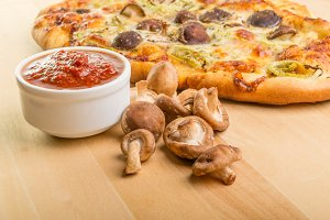 Fresh mushrooms sauce and pizza