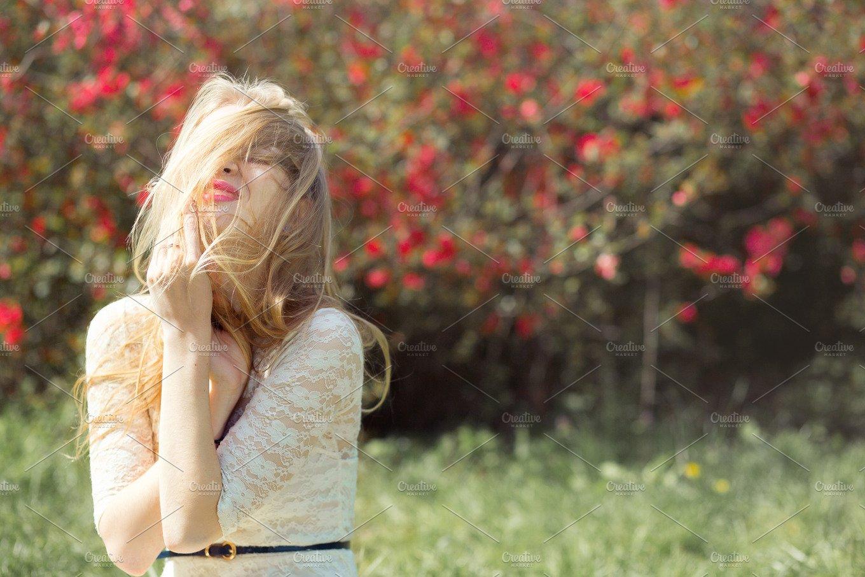 Beautiful blonde girl in pink peach and sakura garden. Female ...