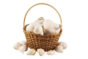 Garlics in a basket over white