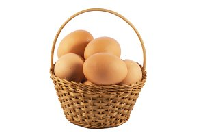 Eggs in a basket over white