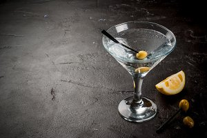 Martini with olives and a lemon
