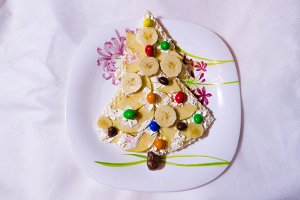Children dessert with bananas and candy.