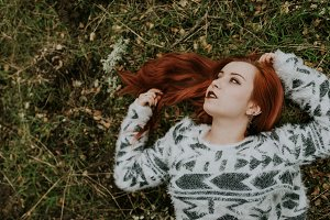 Young pensive redhead woman