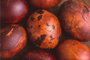 Easter eggs on wooden background. Painted brown with spots and cracks