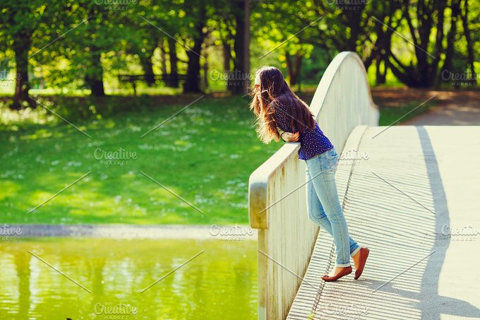 Girl on bridge in park - People