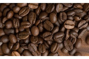 Brown coffee beans, closeup macro for background and texture