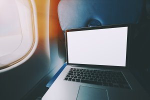 Laptop with blank screen in plane