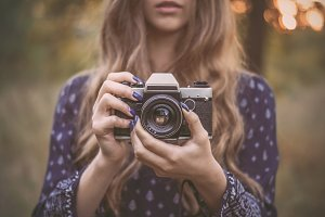 Hipster girl with retro camera
