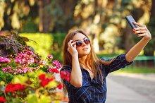 Girl in sunglasses. Selfie