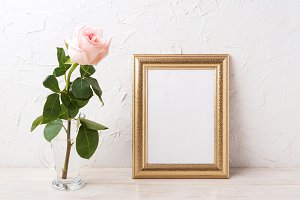 Gold frame mockup with pink rose