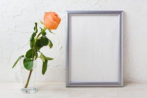 Silver frame mockup with orange rose