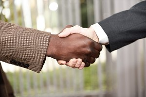 Black businessman shaking hands