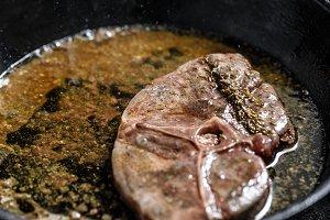 Wild boar steak fried in pan